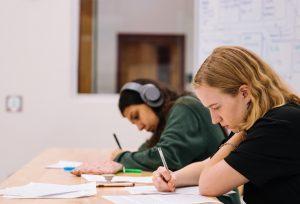 Photo of students writing an exam by Jeswin Thomas on Unsplash