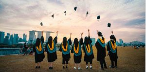 Photo of students throwing graduation caps in celebration by Pang Yuhao on Unsplash
